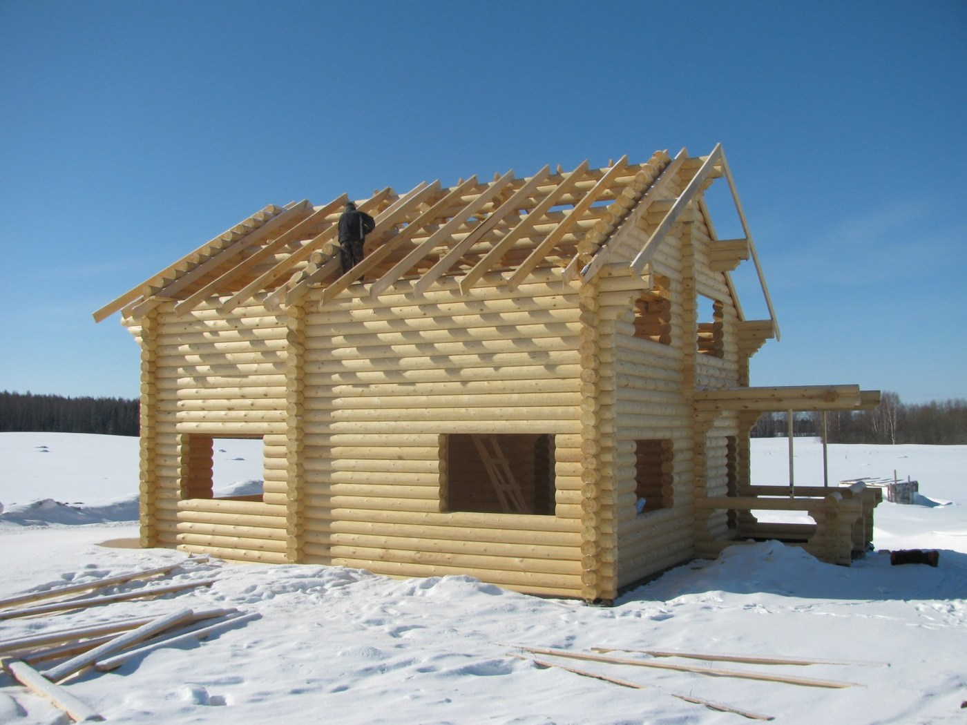 Wooden houses constructions from winter timber