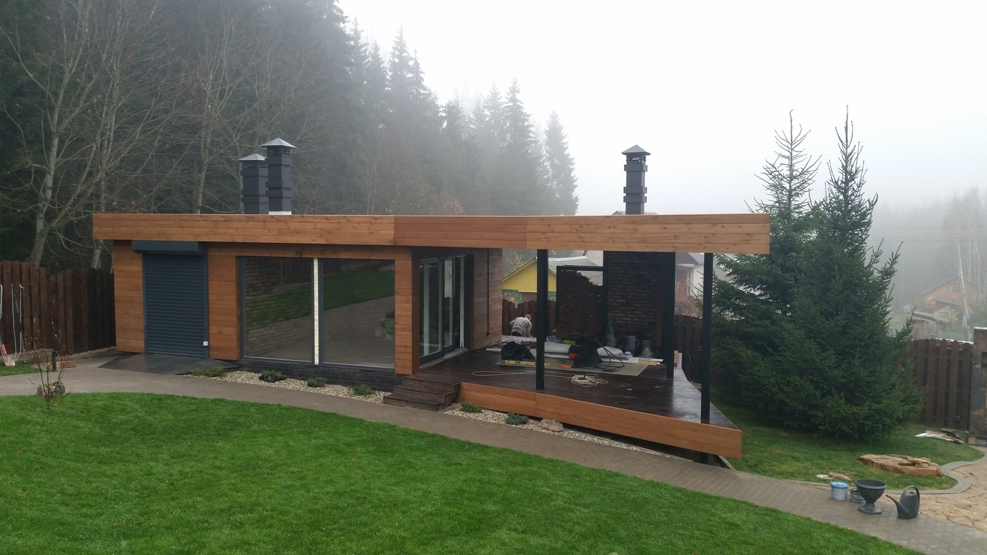 High Quality Properties Of A Flat Roof On A Wooden House