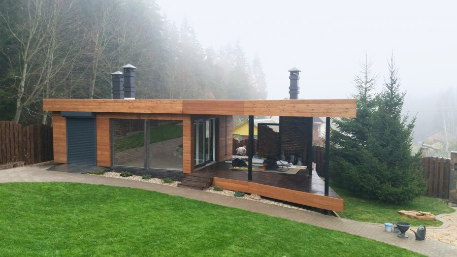Individuality of a wooden house with a flat roof